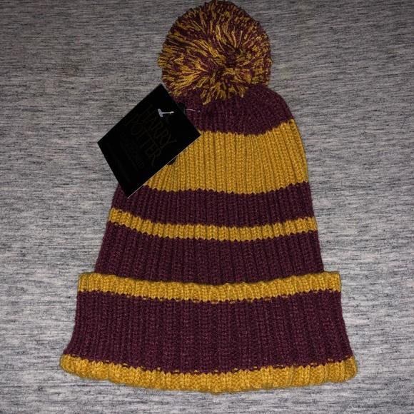 8486fd70fd3 Harry Potter Gryffindor pom pom knit beanie